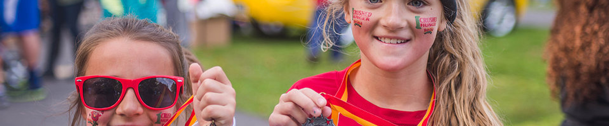 Girls show off medals at Crush Hunger
