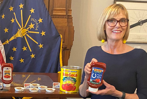 Image of Red Gold VP Tim Ingle and Lt Governor Suzanne Crouch with both holding Red Gold Ketchup