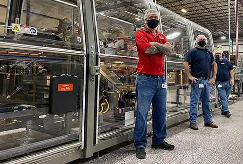Image of High Speed Line behind three employees